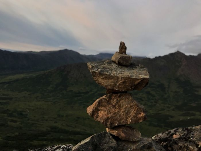Rockstacking while hiking to the top of flattop