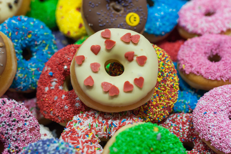 nougat Baked Choice Close-up Dessert Donut Food Food And Drink Freshness Icing Indoors  Indulgence Multi Colored No People Ready-to-eat Snack Sprinkles Still Life Sweet Sweet Food Temptation Unhealthy Eating Variation