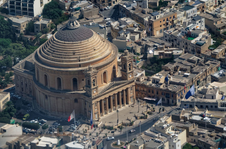 Areal view over the Rotunda of Mosta - the Parish Church of the Assumption, Malta EyeEmNewHere Malta Mosta Rotunda Architecture Areal View Assumption Building Exterior Built Structure City Day Dome Famous Place Historical No People Outdoors Parish Church Place Of Worship Religion Spirituality Summer Travel Destinations Church Historic Catholicism Town Square The Traveler - 2018 EyeEm Awards Aerial View Downtown District Building