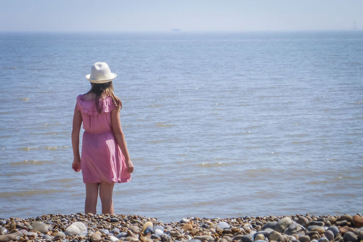 A date out in Thorpeness, Suffolk Beach Beauty In Nature Day Hat Horizon Horizon Over Water Land Leisure Activity Lifestyles Nature One Person Real People Rock Scenics - Nature Sea Sky Standing Suffolk Water Women