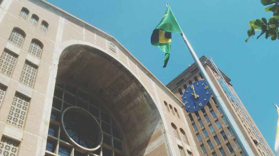 Brazilian Flag By Basilica Of The National Shrine Of Our Lady Of Aparecida