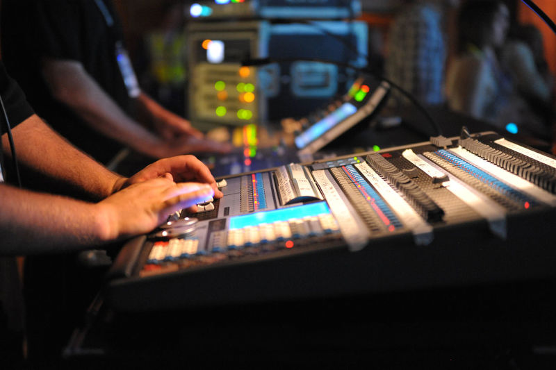 Lighting and Sound Engineers working front of house at a concert. EyeEmNewHere Arts Culture And Entertainment Audio Equipment Close-up Control Panel Human Body Part Human Hand Illuminated Indoors  Men Mixing Music Occupation Real People Recording Studio Skill  Sound Mixer Sound Recording Equipment Technology