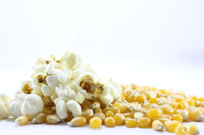 Corn kernels for making popcorn on a white background. Corn Kernels For Making Popcorn On A White Background. Close-up Food Food And Drink Freshness Healthy Eating Heap Nature No People Studio Shot White Background White Color Yellow