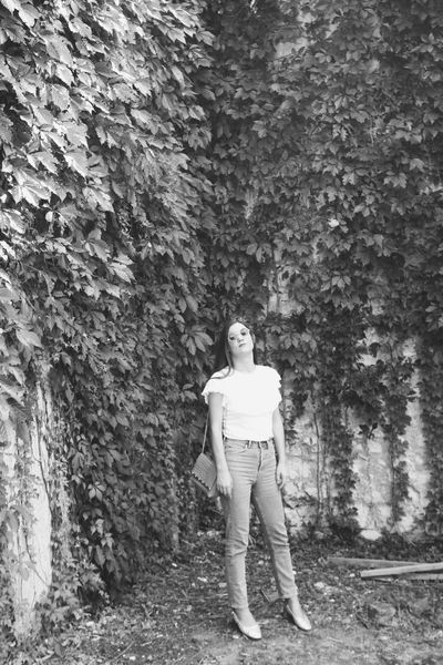 Vogue Minimalism Croatia Blackandwhite Black And White Analogue Photography women around the world Retro Styled Model Shooting Girl Retro Art is Everywhere Real People Leisure Activity Lifestyles Front View Standing Day Men Casual Clothing Young Men Architecture Outdoors Nature Wall - Building Feature Plant Tree Built Structure Young Adult