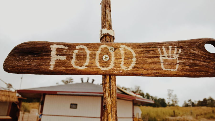 Food sign Communication Day Guidance Information Metal No People Old Old-fashioned Safety Sign Symbol Text Wall Weathered Western Script Wood Wood - Material Wooden Gotland, Sweden Fårø Sudersand