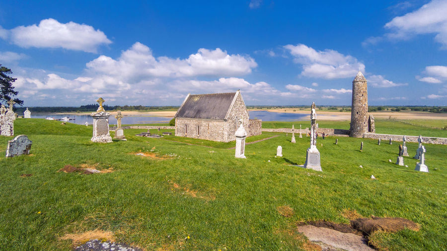 Silence of Clonmacnoise Clonmacnoise Ruins Ancient Abandoned Old The Past Cloud - Sky Cemetery Grave Grass Tombstone Architecture Sky History Built Structure Stone Landscape Nature Religion Land Day Field No People Outdoors Ireland