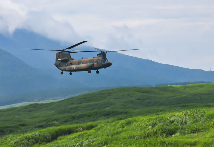 Boeing CH-47 Chinook flying during exercise Fuji Fire power area Mt Fuji Japan. Exercise Transport Helicopter Air Vehicle Army Flying Helicopter Japan Military Military Training Transportation
