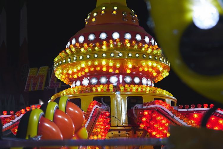 Carnival Fun Amusement Park Built Structure Illuminated Lifestyles Lighting Equipment Multi Colored Night No People Outdoors Sky