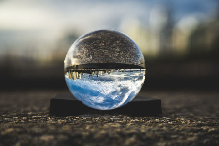 Close-up Crystal Ball Focus On Foreground Lens Ball Reflection Selective Focus Sky Sphere