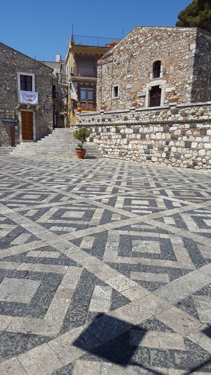 Castelmola Italy-Castelmola is a comune in the Province of Messina in the Italian region Sicily. History Architecture Outdoors Building Exterior No People Built Structure Day Travel Destinations Shadow Beautiful Day Beautiful Castelmola Italy Brick Buildings Vacation Photo Vacation Stone Walkways Flowers And Plants