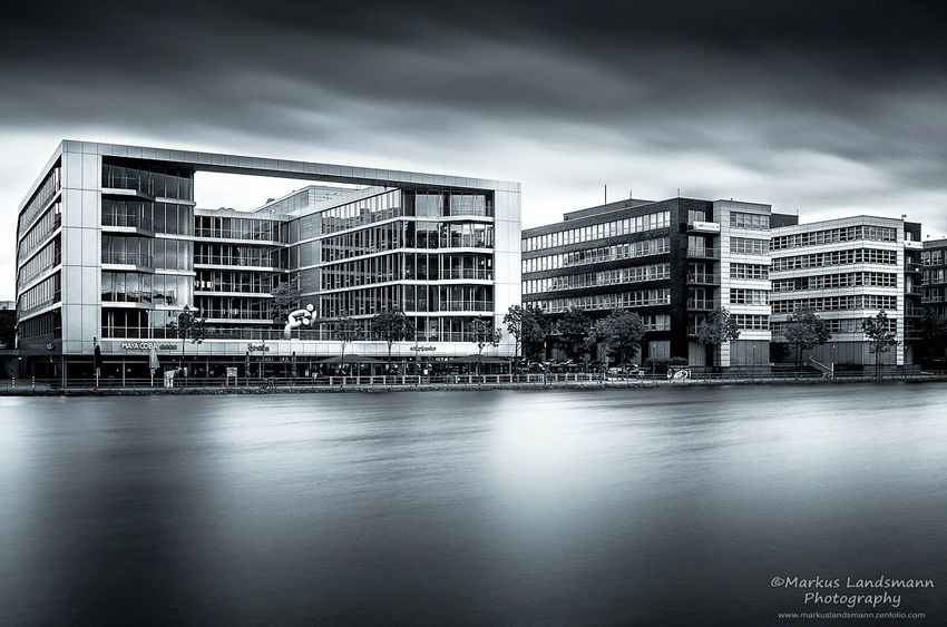 Duisburg Inner harbor. A long exposure made with a 10 f-stop Formatt-Hitech nd-filter. Duisburg City Architecture No People Outdoors Cityscape Blackandwhite Long Exposure Longexposure Fine Art Photography ND Filter Fine Art Bwoftheday Black And White Collection  Pentax K-5 Firecrestfilters Formatt Hitech Day Dramatic Sky Weather Sky Architecture River Water Urban Exploration
