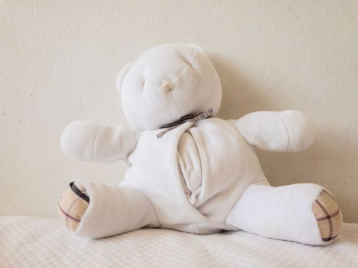 White teddy bear on a white bedcover against a white wall. Copy Space White Teddy Bear White Color White Background Teddy Bear EyeEm Selects Indoors  Textile White Color Still Life Representation Close-up No People Beauty Softness Single Object A New Beginning