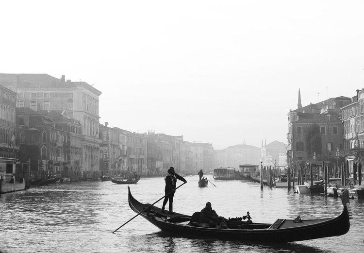 """""""La gondola nera, slanciata, e il modo in cui si muove, lieve, senza rumore alcuno, ha qualcosa di strano, una bellezza da sogno, ed è parte integrante della città dell'ozio, dell'amore e della musica."""" - Hermann Hesse Venezia Canal Grande Gondola B&w EyeEm Best Shots EyeEmNewHere EyeEm Gallery EyeEmBestPics Picoftheday Gondola - Traditional Boat City Gondolier Water Boat Canal Gondola Venice - Italy Grand Canal - Venice Water Vehicle The Street Photographer - 2018 EyeEm Awards The Traveler - 2018 EyeEm Awards #urbanana: The Urban Playground Be Brave My Best Photo"""