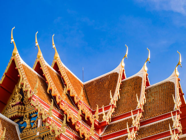Close up of old thai temple roof in the morning with beautiful blue sky, copy space. Gold Thailand Architecture Belief Blue Building Building Exterior Built Structure Day Low Angle View Nature No People Old Old Buildings Ornate Outdoors Pattern Place Of Worship Religion Roof Sky Spirituality Sunlight Temple Travel Destinations