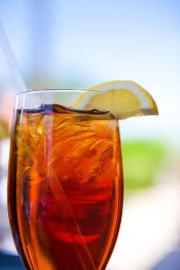 Close-Up Of Cropped Drink Against Blurred Background