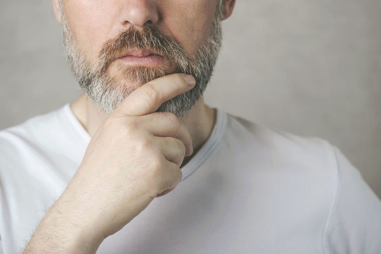 Man Thoughtful Think Beard Confused Doubt Lifestyle Emotional Sad Concentration Expression Puzzled Portrait Reflection Serious Solve Solutions People Concept Problem Mature Man Thinking Male Face Hand Elder Adult Worried Closeup Unhappy Facial Hair Men Gray Background Human Body Part Close-up Mature Adult Mature Men Contemplation Headshot