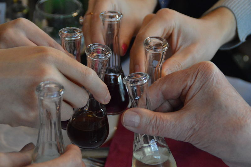 Close-Up Of Hands Toasting Alcohol