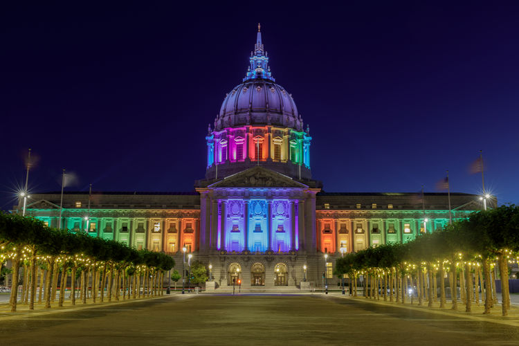 San Francisco City Hall illuminated in rainbow colors for the Pride Parade. San Francisco, California, USA. Building Exterior Built Structure Architecture Illuminated Night Travel Destinations Dome Sky History Government Travel City Building Tourism No People Façade City Hall San Francisco Rainbow Gay Pride Pride Parade Pride Festival Gay Pride Parade Skyline Town Square Skyscraper Tower Celebration Colorful Lights Government Courtyard  Federal Renaissance America Monument Cityscape Architecture City Blue Sky California Tourist Attractions Sightseeing Evening Dusk Historic USA Municipal Event