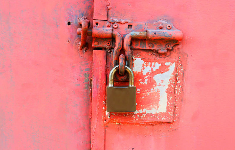 Close-up Closed Connection Day Door Entrance Latch Lock Metal No People Old Outdoors Padlock Protection Red Safety Safety Equipment Security Wall - Building Feature Weathered Wood - Material