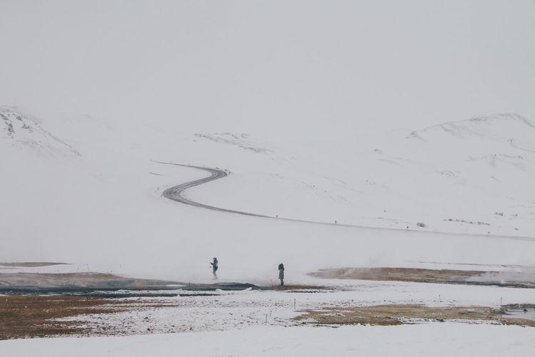 Adventure Beauty In Nature Cold Temperature Day Deep Snow Hverarönd Iceland Landscape Leisure Activity Mountain Nature Outdoors People Powder Snow Scenics Snow Track - Imprint Tranquil Scene Tranquility Travel Vacations Weather White Color Winding Road Winter