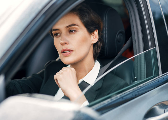 Thoughtful businesswoman driving car