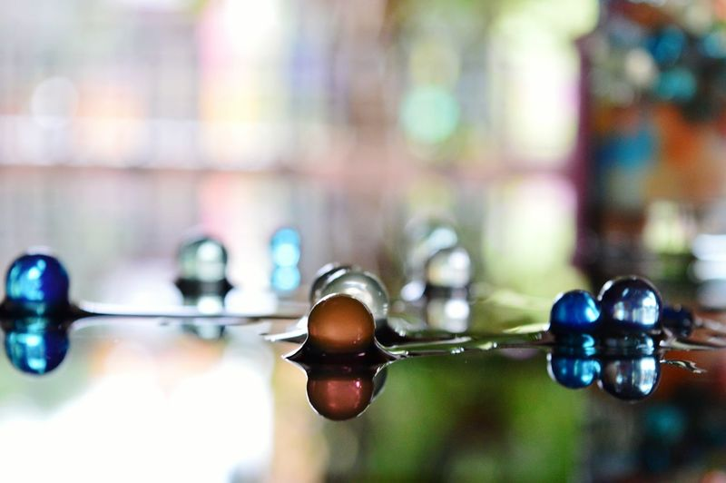 Close-up of wet marbles on table