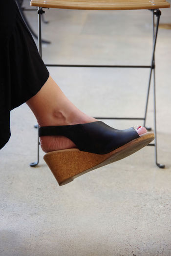 Low section of woman wearing heels