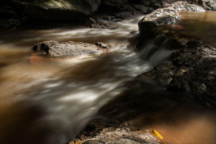Water flows through the rocks on the mountain