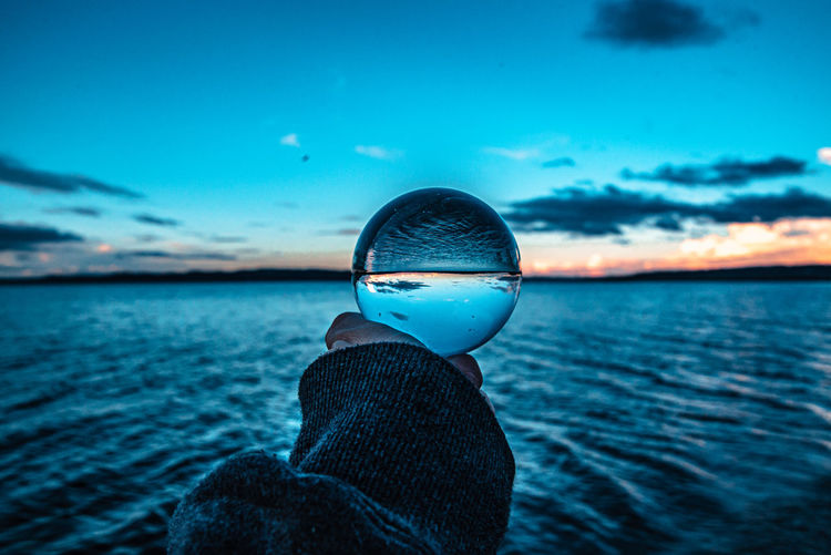 Lensball in golden hour over the water against the sky