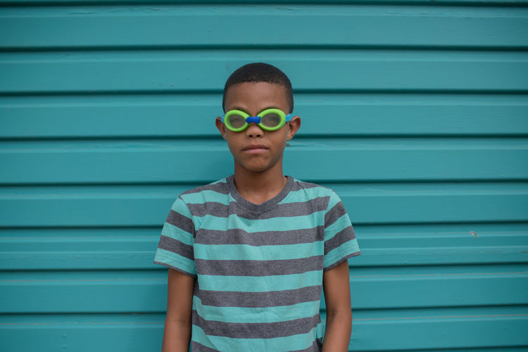 Blend in or stand out African Green Green Color Boys Child Childhood Children Only Corrugated Iron Day Males  One Boy Only One Person Outdoors People Standing Striped