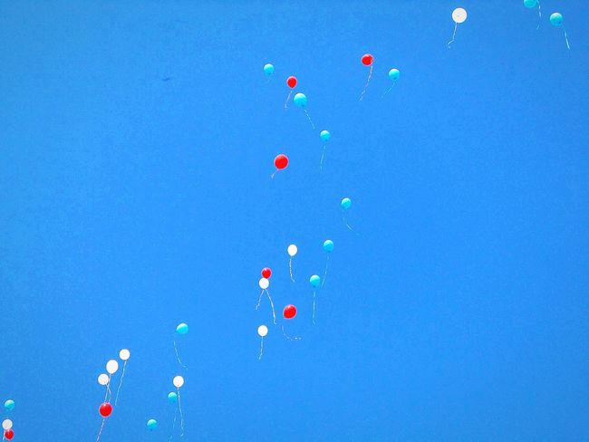 Multi Colored Blue Red White Vibrant Color Flying Event Funeral Worland WY Wyoming Sky Tranquil Scene Tranquility Sky Only Balloons