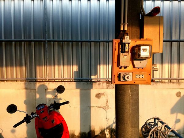 The old control panel on concrete post in parking area with sunlight in the morning Control Panel CutOut Circuit FUSE Mitre Electric System Roof Metal Checkered Plate Old Parking Area Light Shadow Motorcycle Morning EyeEm Selects Built Structure Architecture Day Building Exterior Outdoors No People