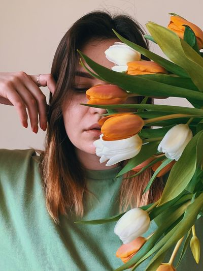 Spring woman tulip face real people