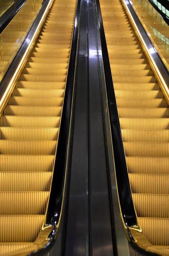Escalator Rolltreppe Gold Upstairs GERMANY🇩🇪DEUTSCHERLAND@ Architecture Modern Illuminated Futuristic Berlin Photography Treppe Golden Light Goldenway Starway To Haven The City Light Illumination Steel Structure