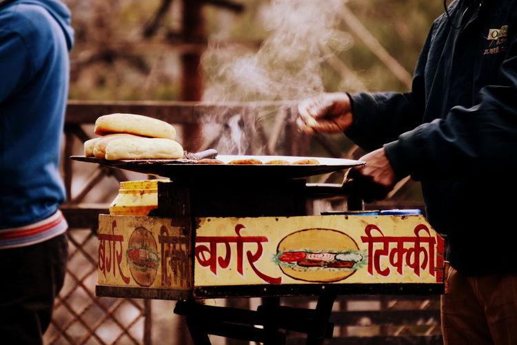 Midsection of man preparing food at street