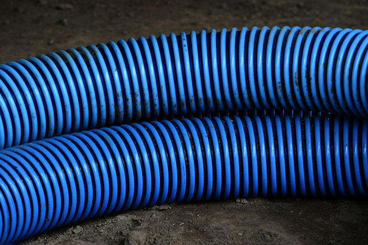 High angle view of blue pipes on field at construction site