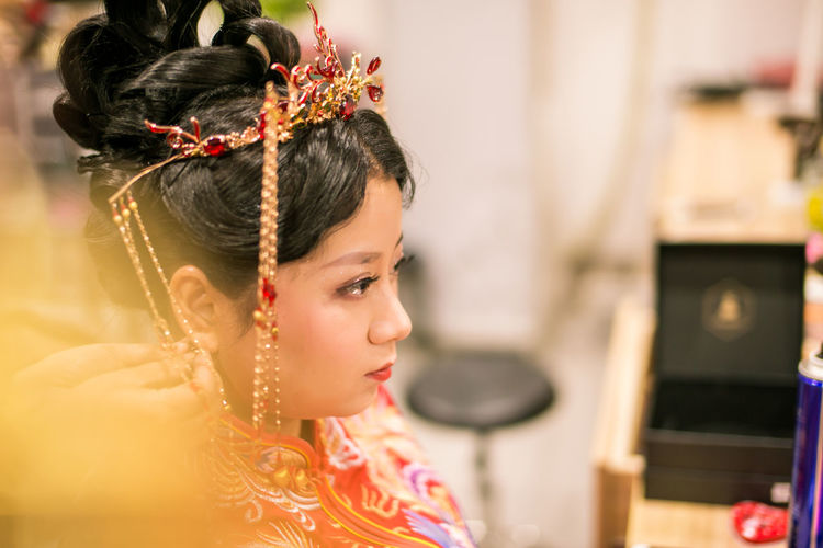 Close-up of bride looking away during wedding ceremony