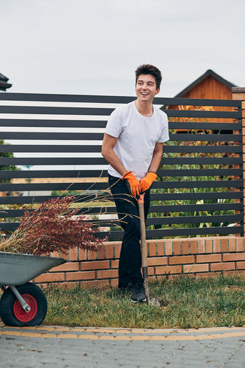 Young man standing at yard