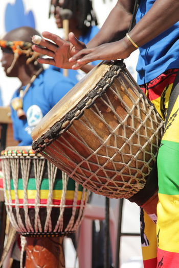 Adult African Drums Close-up Day Djembe Djembedrumming Drum Human Body Part Human Hand Midsection Musical Instrument Outdoors People Teamwork