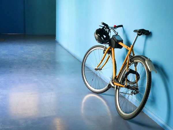 Bicycle Land Vehicle Transportation Mode Of Transportation Stationary No People Indoors  Wall - Building Feature Day Parking Architecture Blue Built Structure City Sport Wheel