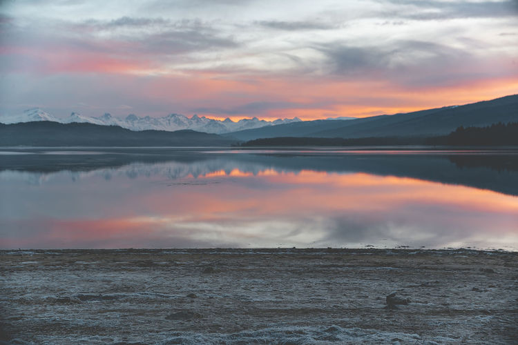 Shaori Lake Sunset Water Beauty In Nature Cloud - Sky Scenics - Nature Sky Tranquil Scene Tranquility Orange Color Lake Reflection No People Idyllic Non-urban Scene Mountain Nature Waterfront Dramatic Sky Outdoors Salt Flat Ambrolauri Georgia Shaori Lake Morning Sunrise