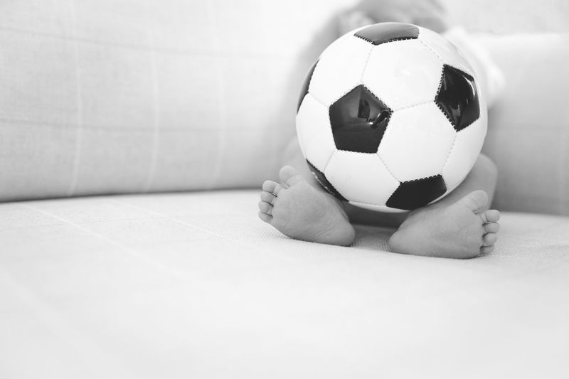 Low section of a baby with ball