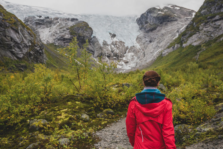 Bergsetbreen #2 Rear View One Person Mountain Rock Rock - Object Beauty In Nature Scenics - Nature Nature Real People Day Adult Red Clothing Looking At View Women Solid Mountain Range Lifestyles Outdoors Hood - Clothing Glacier Norway Scandinavia Discovering Places Travel Photography
