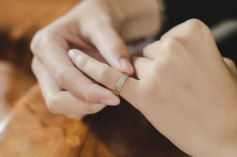 Close-up of woman holding ring