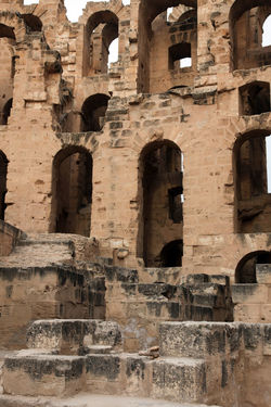 The amphitheater in El Jem, Tunisia Abandoned Africa Amphitheater Ancient Arches Architecture Arena Building Exterior Built Structure El_jem Empire Erosion Famous Place Gladiator, Heritage History Landmark Old Ruin Roman Ruined Stone Stone Wall Tunisia Unesco Wall - Building Feature