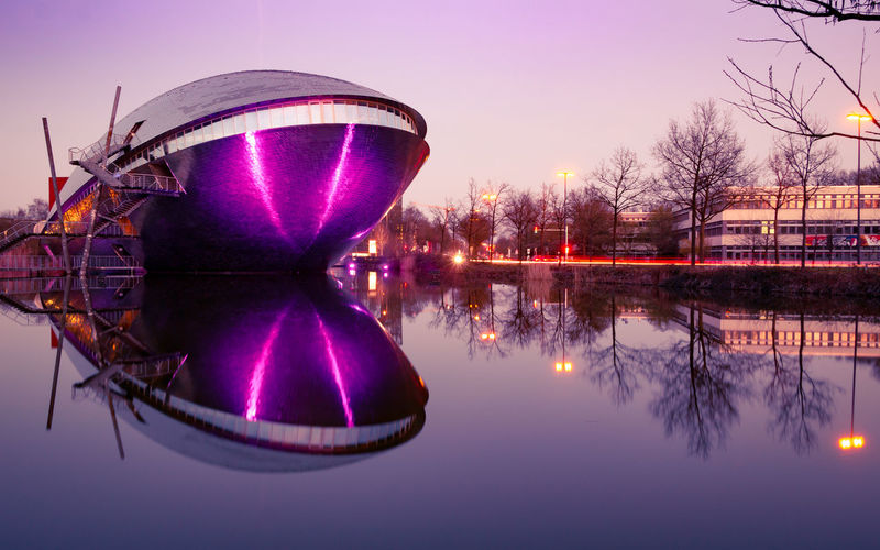 Reflection Water Sky Waterfront Lake Nature Tree Illuminated No People Plant Standing Water Architecture Symmetry Dusk Built Structure Clear Sky Building Exterior Sunset Purple Nightlife