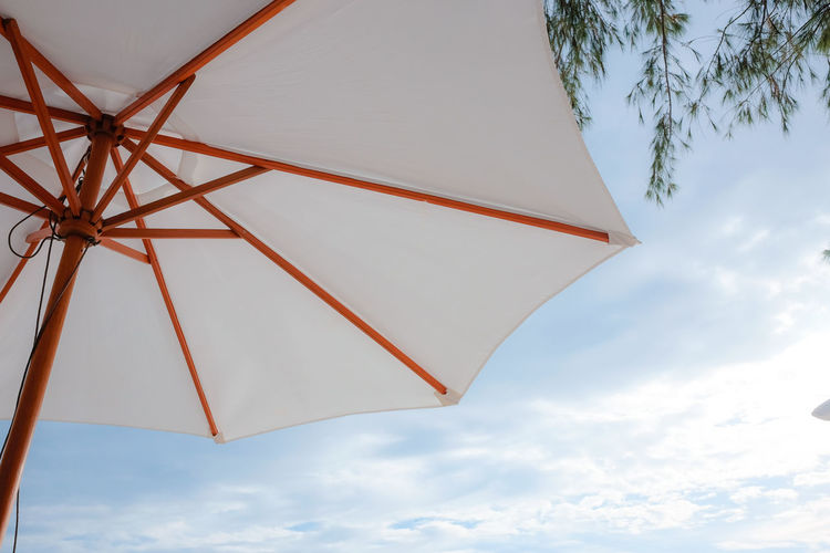 Architecture Built Structure Cloud - Sky Day Low Angle View Nature No People Outdoors Parasol Pattern Protection Safety Security Shade Shelter Sky Sunshade Umbrella White Color