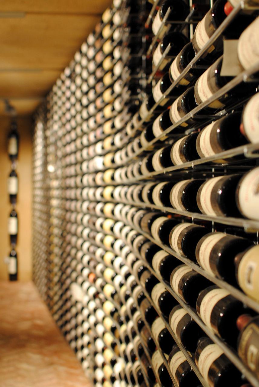 Stack Of Wine Bottle In Cellar