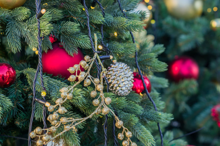 Close up of christmas tree decorated with gold small balls. new year background