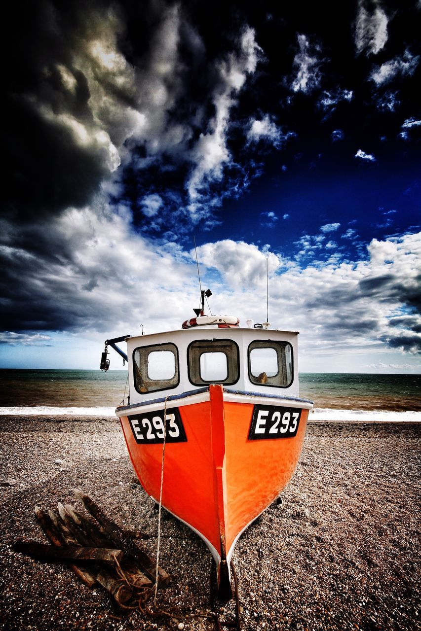 SCENIC VIEW OF Moored Boat AGAINST CLOUDY SKY